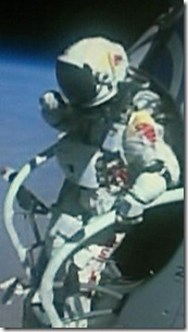 Baumgartner stands on the capsule step - 24 miles above the Earth